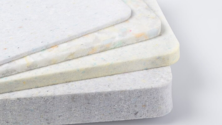 Composite materials are manufactured on the basis of recycled foam scraps and are characterised by excellent insulation and absorption properties